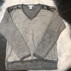 High low knitted sweater design history